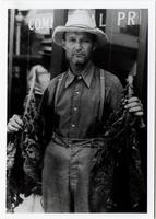 Montgomery County Tobacco Farmer Holding Tobacco Leaves