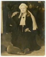 [portrait photograph of Virginia P. Moore wearing the dress, and lace worn by Queen Victoria at one time]
