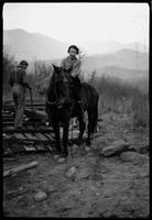Mildred Webster (Miller). With Whaley boy & his horse (dragging logs from dismantled cabins)