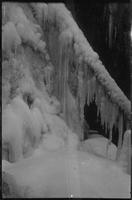 Behind a frozen curtain. This picture was snapped by Harvey Broome on hike down Roaring Fork. All falls were frozen. We made entrance behind this fall thru hole at lower right of picture